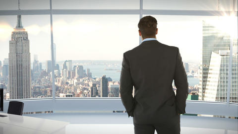 Rear view of businessman standing in office Live Action