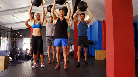 Group of people exercising with exercise ball Footage