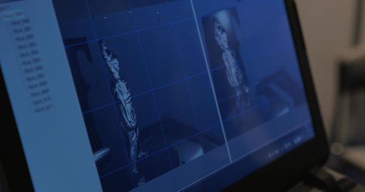 3D model of figurine on computer screen