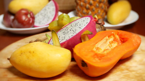 exotic fruits on the table. 4k, carambola and dragon fruit, papaya, mango Live Action