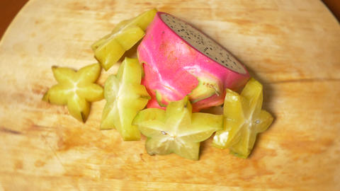 exotic fruits on the table. 4k, carambola and Dragonfruit, cut into pieces Live Action