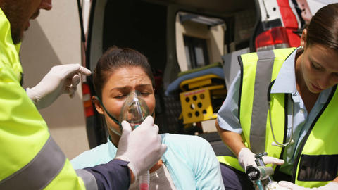 Patient receiving oxygen mask from ambulance team Live Action