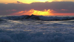 Great waves rolling towards the shore during sunset, slow mo Footage
