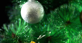 Decorated Christmas tree with baubles rotation 4k extreme close-up video Footage