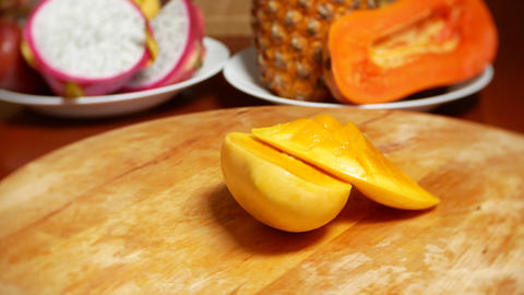 exotic fruits on the table. 4k, mango, passion fruit, fruit cut into pieces Live Action