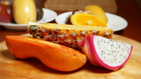 exotic fruits on the table. 4k, dragon fruit, papaya, pineapple chopped, rotate Live Action