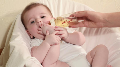 baby boy bottle feeding Stock Video Footage