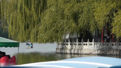 People boating on lake relying on China Beijing Beihai... Stock Video Footage