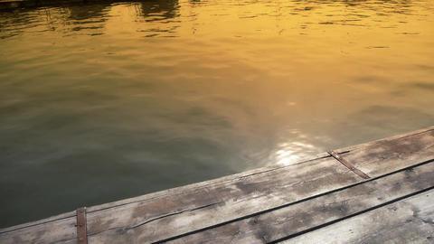 Ripples waves on lake & wood piers,sun light... Stock Video Footage
