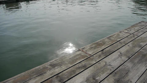 Panoramic of Ripples waves on lake & wood piers,sun... Stock Video Footage