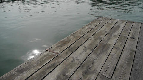 Panoramic of Ripples waves on lake & wood piers,sun light reflection in wate Footage