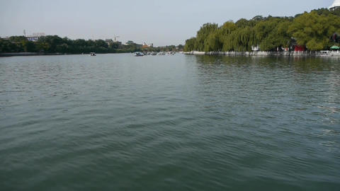 China Beijing Beihai Park lake water & willow island Stock Video Footage