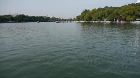 China Beijing Beihai Park lake water & willow island Stock Video Footage
