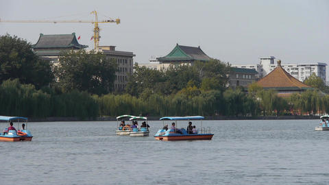 People boating at China Beijing Beihai Park & willow... Stock Video Footage