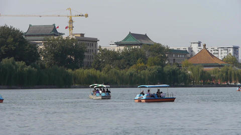 People boating at China Beijing Beihai Park & willow island Footage