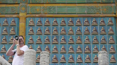 tourist photography & ancient east buddha totem wall Footage