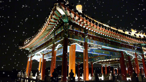 China Beijing ancient architecture pavilions & falling snow at night Footage