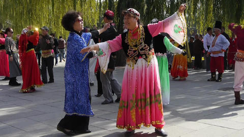 uyghur dancer under sun Stock Video Footage