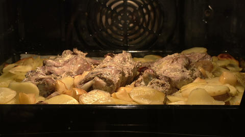 Meat dish in the oven HD Stock Video Footage