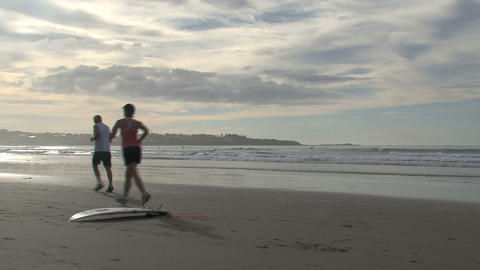 Morning run at the beach Stock Video Footage