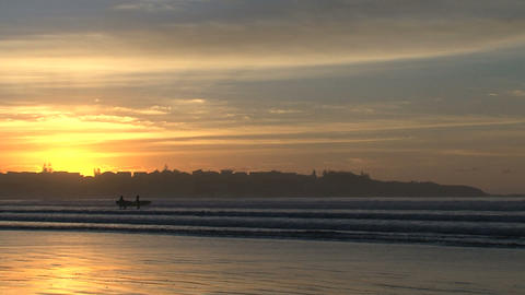 surfer walking in to the sea Stock Video Footage