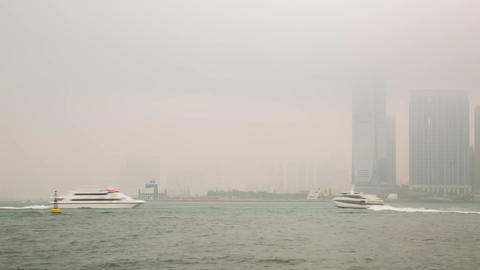 Boat Traffic on a foggy morning by ICC building Stock Video Footage