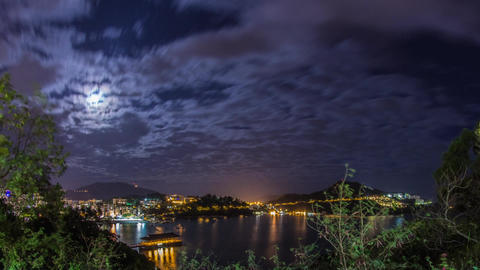 Cloudy night of Stanley Bay with moon rising Stock Video Footage