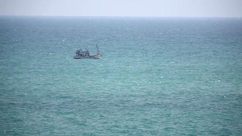 Fishing ship in open sea timelapse Stock Video Footage