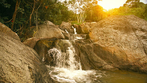 Waterfall in summer mountain at sunset Footage