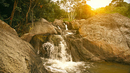 Waterfall in summer mountain at sunset Stock Video Footage