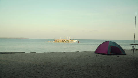 Tent for camping on a tropical beach Live Action
