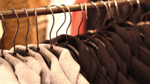 Designer cashmere coats hanging in famous brand boutique Live Action