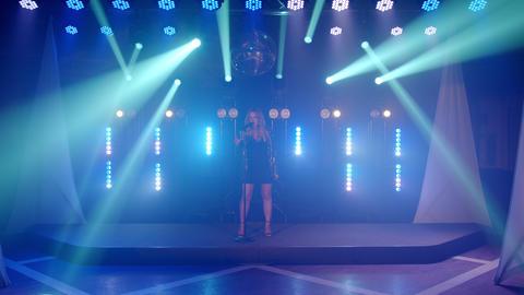 Live vocal performance of emotional singer in short dress, vocalist girl dancing Live Action