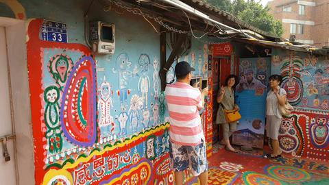 Woman pose for outdoor gallery Rainbow village Footage