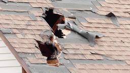 Wind blown debris penetrates roof Footage
