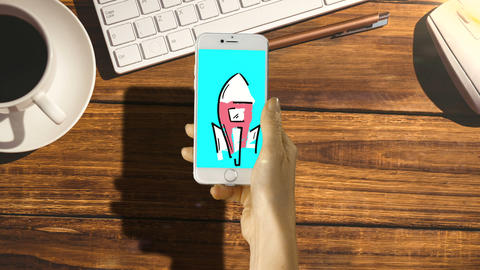 Hand touching digitally generated icon on mobile phone Live Action