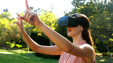 Beautiful woman using virtual glasses Footage
