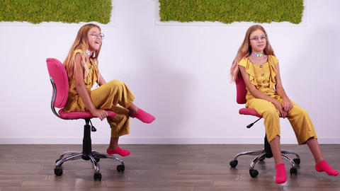 Replicated image of girl in yellow suit turning on chair Live Action