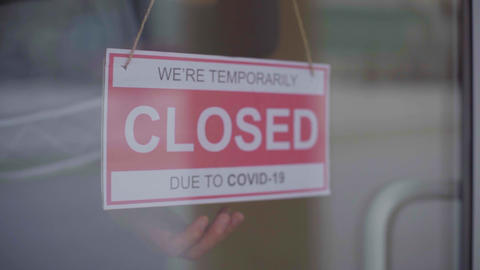 Sign we are open after covid. We Are Open Sign on the Glass Door. Slow motion Live Action