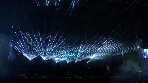Light beams rays moving lights colored clouds running in the lights colored lasers on a huge stage Live Action