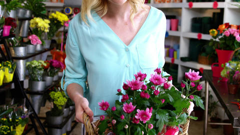 Female florist holding bunch of flowers in flower shop Footage