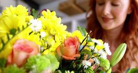 Female florist smelling flower Footage