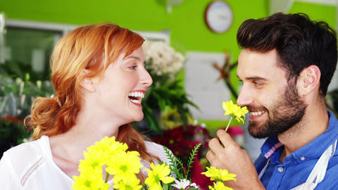 Happy florists smelling flower Footage