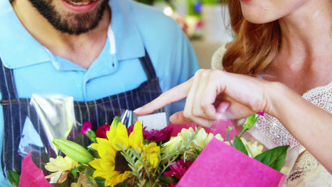 Close-up of florists checking flower bouquet Footage