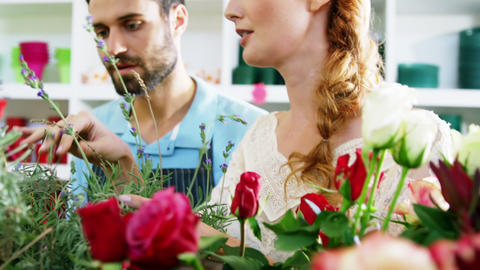 Florists checking flowers in flower shop Stock Video Footage