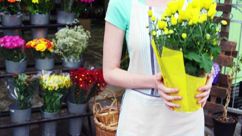 Female florist holding bunch flowers in flower shop Footage