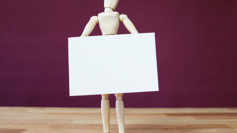 Figurine holding blank placard Stock Video Footage