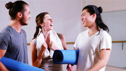 Group of fitness team interacting in fitness studio Footage