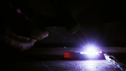 Close-up of welder using welding torch Live Action
