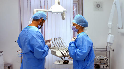 Dentists working in dental clinic Live Action